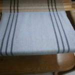 Halsduk, ull i varp och inslagBredd 30,5 cm.
